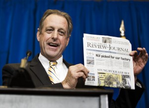 North Las Vegas Mayor John Lee holds a copy of the Las Vegas Review-Journal during Faraday Future announcement at the Sawyer Building on Thursday, Dec. 10, 2015. The auto manufacturing company is scheduled to build a $1 billion auto factory at Apex in North Las Vegas. Jeff Scheid/ Las Vegas Review-Journal Follow @jlscheid