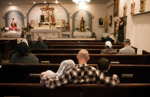 A family sits during Latin Mass conducted by Rev. Rev. Courtney Edward Krier at St. Joseph's Catholic Church,131 N. Ninth Street on Sunday, Nov. 18,2015. On Sunday's Krier conducts two English masses and one in Spanish then travels to Needles, Cal. for an afternoon mass. Jeff Scheid/ Las Vegas Review-Journal Follow @jlscheid