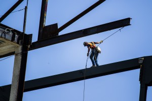 An ironworker guides a beam into place at the MGM Resorts International-AEG arena construction site behind New York-New York casino-hotel onThursday, April 23, 2015. The $375 million arena is scheduled to open in April 2016. (Jeff Scheid/Las Vegas Review-Journal) Follow Jeff Scheid on Twitter @jlscheid