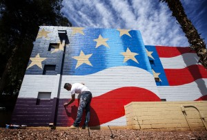 Artist Scott LoBaido paints an American flag on the wall at the America Legion Post 08 building, 733 N. Veterans Memorial Drive, on Monday, April 6, 2015. LoBaido is on a six-month national tour to paint the Stars and Stripes on American Legion Post or VFW buildings in all 50 states. It will take him three days and nine gallons of paint to do the Las Vegas project. (Jeff Scheid/Las Vegas Review-Journal) Follow Jeff Scheid on Twitter @jlscheid