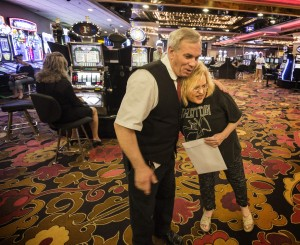 Long time Riviera hotel-casino employees Glenn Ceomeau 15 years working as shoeshiner, and Nancy Burgess, 27 years as a cashier hug in the casino on Monday, May 4, 2015. The casino closed today after 60 years on the Las Vegas Strip. (Jeff Scheid/Las Vegas Review-Journal) Follow Jeff Scheid on Twitter @jlscheid
