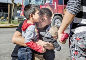 A man who declined give his name hugs his four-year old and his two-year old sons Friday, Feb 27, 2015 after a house fire broke out at the boys home, located north on U.S. 95 and east of Rancho. The man's ex-wife and the boys lived at the homewhen the fire broke out around 11:15. (Jeff Scheid/Las Vegas Review-Journal)