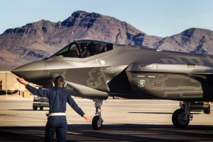 A flight line member directs at F-35 Lightning II stealth fighter jet piloted by Capt. Brent Golden at Nellis Air Force Base on Thursday, Jan.15, 2015. The United States Air Force Weapons School at Nellis received its first F-35. The high-tech F-35 joint strike fighter jet is the U.S. military's most expensive weapons system. (Jeff Scheid/Las Vegas Review-Journal)